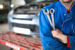 Hand of car mechanic with wrench. Auto repair garage Stock Photo