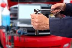 Hand of car mechanic with wrench. Stock Photos