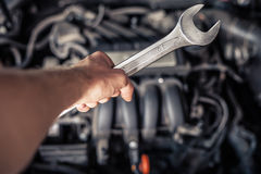 Hand of car mechanic with wrench. Stock Images