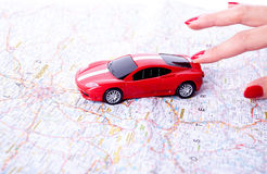Hand with a car and road map Royalty Free Stock Photography