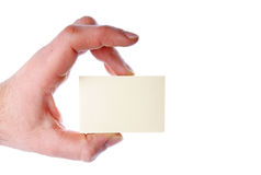 Hand with a Card. Hand holding a note over a white background Stock Photo