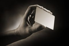 Hand card. Body language hand hold the blank business card royalty free stock photos