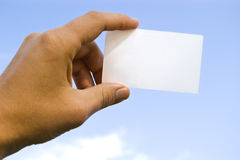 Hand and card Royalty Free Stock Photos