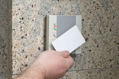 Hand with the card access. Man puts the card into the reader access Royalty Free Stock Photos