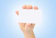 Hand and a card isolated Royalty Free Stock Images