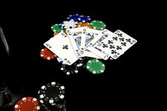 Hand of card player with royal flush Stock Photos
