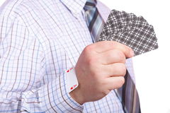 Hand and card in sleeve isolated Royalty Free Stock Photography