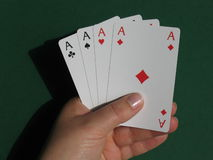 Hand with cards. A hand with cards with green background stock photo
