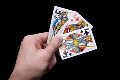 Hand with cards Stock Images