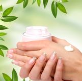 Hand care on green Royalty Free Stock Image