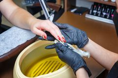 Hand care with hot wax, covering with wax, manicure salon.  stock photo