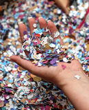 Hand with carnival confetti and money Royalty Free Stock Photos
