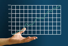 Hand carry the stock market's graph Stock Images