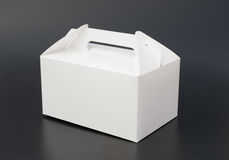 Hand carry white box. On black background Royalty Free Stock Photos