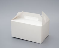 Hand carry white box. On grey background Royalty Free Stock Images