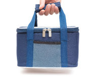 Hand carrying a blue lunch pack carrier Stock Image