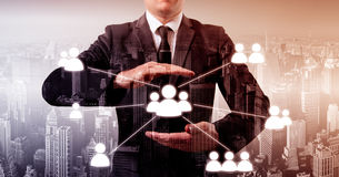 Hand carrying businessman icon network - HR,HRM,MLM, teamwork and leadership concept Stock Photos