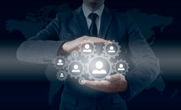 Hand carrying businessman icon network - HR,HRM,MLM, teamwork and leadership concept Stock Images