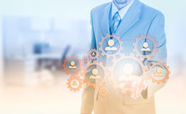 Hand carrying businessman icon network - HR,HRM,MLM, teamwork and leadership concept Stock Image