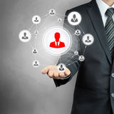 Hand carrying businessman icon network - HR, MLM & team work concepts Stock Photos
