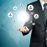 Hand carrying businesspeople icon network with blank circle in the middle Stock Image