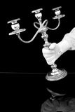 Hand carrying a candelabra Stock Images