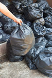 Hand carrying garbage bag Stock Photography