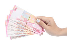 Hand carrying money Indonesia Stock Photos