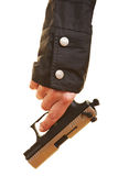 Hand carrying pistol Stock Images