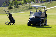 Hand cart with golf clubs. Golf field Royalty Free Stock Images