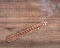 Hand carved burner, holder with sandalwood incense Royalty Free Stock Images