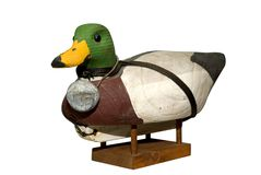 Hand carved Mallard Drake Decoy Duck. Isloated over white with a clipping path Royalty Free Stock Image