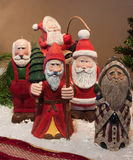 Hand carved Santa Claus figures Stock Images