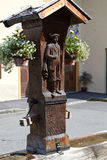 Hand carved well in Bavaria, Germany Stock Photography