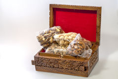 Wooden box with many nuts in it Stock Images