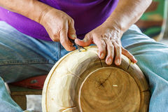 Hand of carver carving wood Royalty Free Stock Image