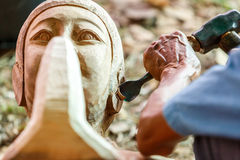 Hand of carver carving wood Royalty Free Stock Photography