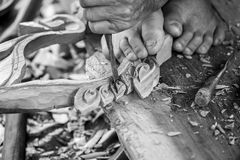 Hand of carver carving wood in black and white color tone Stock Photography