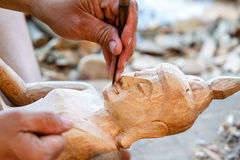 Hand of carver carving wood Stock Photography