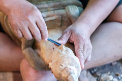 Hand of carver carving wood Royalty Free Stock Photos