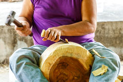 Hand of carver carving wood Stock Photo