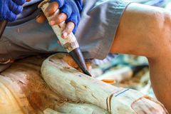 Hand of carver carving wood Royalty Free Stock Photo