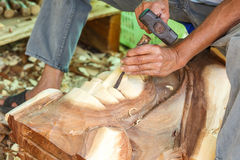 Hand of carver carving wood Royalty Free Stock Images