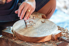 Hand of carver carving wood Stock Image