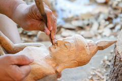 Hand of carver carving wood. Photo Hand of carver carving wood Royalty Free Stock Photos