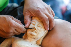 Hand of carver carving wood. Photo Hand of carver carving wood Stock Photography
