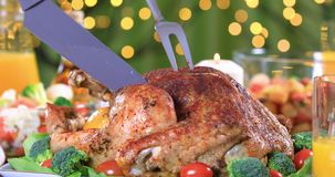 Hand carving slices of roasted turkey for dinner stock video footage