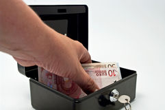 Hand and cash box. On white background Stock Image