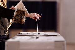 Hand casting a vote into the ballot box Royalty Free Stock Photography