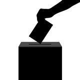 Hand casts ballot in the ballot box in elections silhouette Stock Images